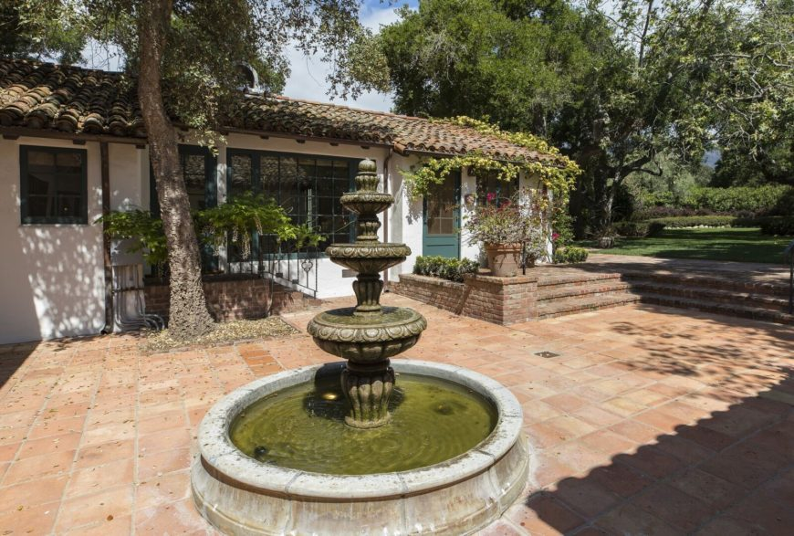 The courtyard also has a charming fountain. The garden can be accessed from here as well. Images courtesy of Toptenrealestatedeals.com.