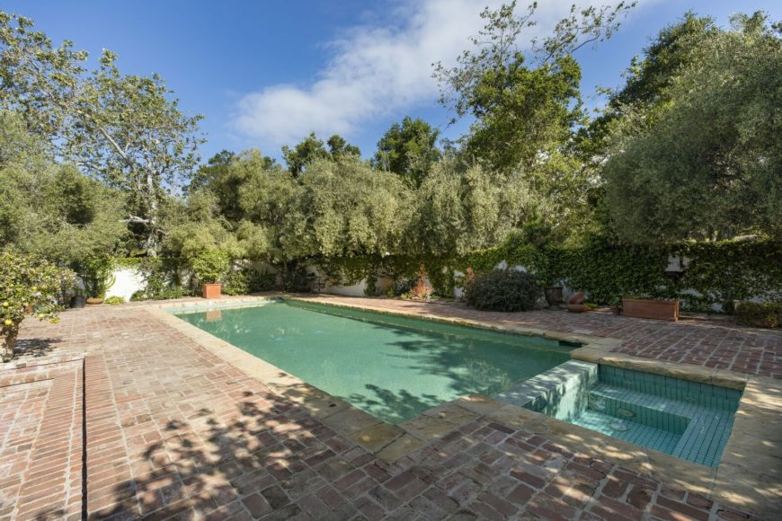 The home offers many outdoor amenities such as an outdoor swimming pool surrounded by mature trees providing shade. Images courtesy of Toptenrealestatedeals.com.