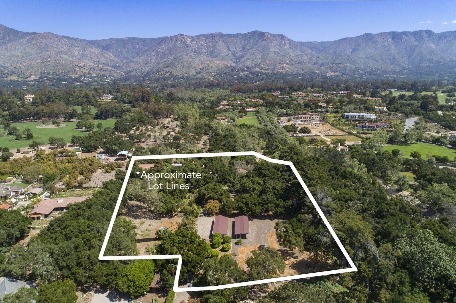 An aerial view of the property showing the house and the nature surrounding it. Images courtesy of Toptenrealestatedeals.com.