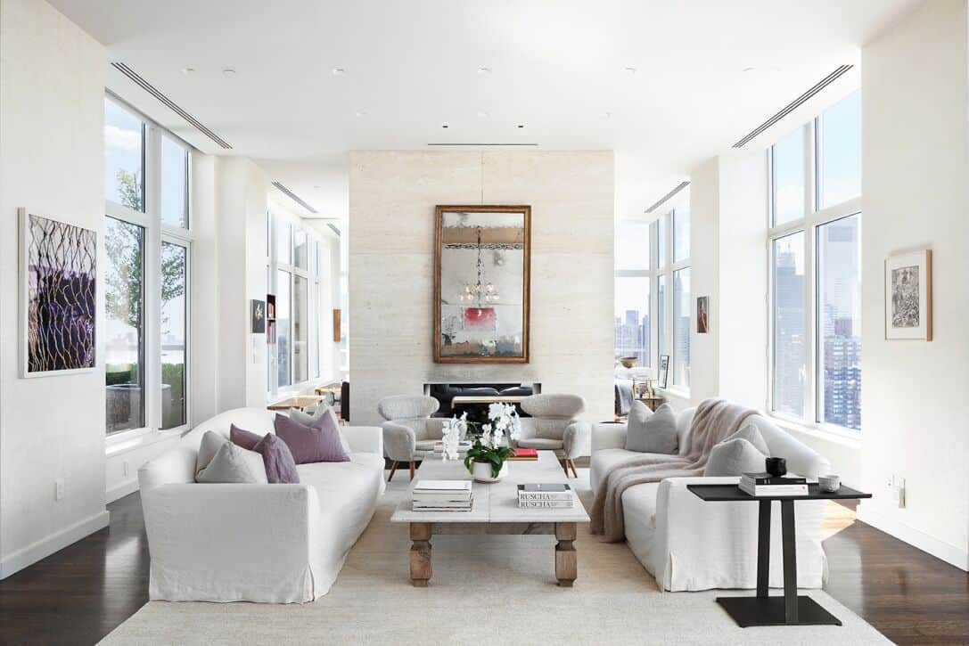 Large living space featuring white walls and a white ceiling pairing with the white sofa set with a gorgeous center table with a white top. Images courtesy of Toptenrealestatedeals.com.