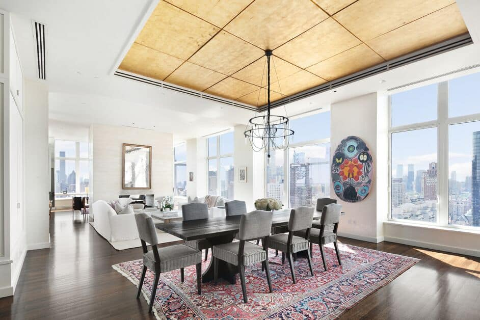 Interior of Jennifer Lawrence's Manhattan Penthouse showcasing the modern style great room with living space and a dining area.