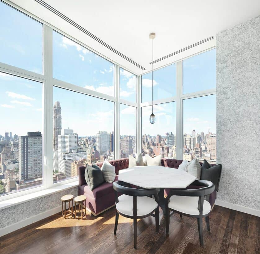 Another one of the home's dining nook. This one boasts gorgeous set of seats and a table, set by the glass windows overlooking the stunning city. Images courtesy of Toptenrealestatedeals.com.