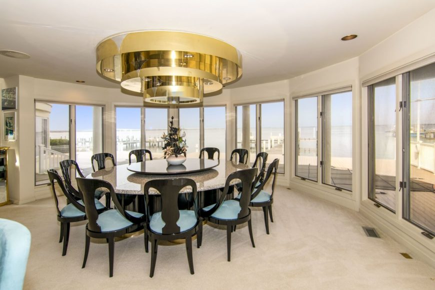 Another look at the dine-in kitchen's large round dining table set just below the room's elegant custom ceiling. Images courtesy of Toptenrealestatedeals.com.