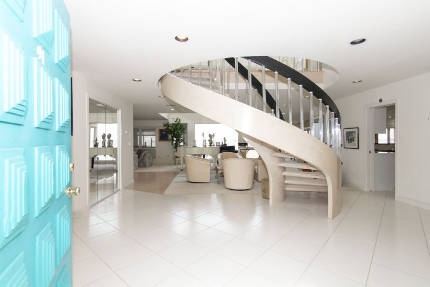 Another look of the foyer from the front door,boasting the gorgeous large spiral staircase along with the white tiles flooring. Images courtesy of Toptenrealestatedeals.com.
