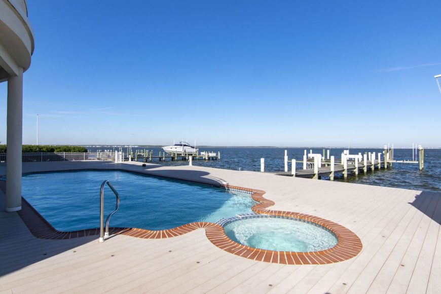 The deck with a custom swimming pool has a direct access to the boat's dock. Images courtesy of Toptenrealestatedeals.com.