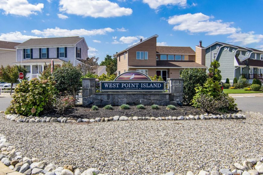 A focused shot at the area's West Point Island sign built beautifully from stone. Images courtesy of Toptenrealestatedeals.com.