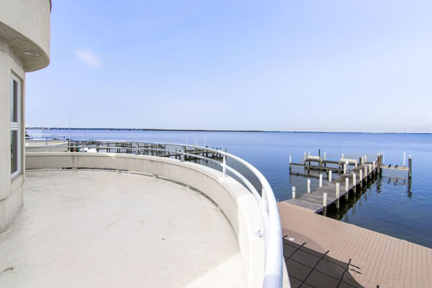 A view of the dock from the home's balcony area. Images courtesy of Toptenrealestatedeals.com.