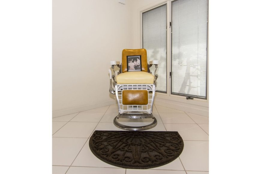 A focused look at this classy-looking chair set in the corner, near the windows. The area features white tiles floors and white walls. Images courtesy of Toptenrealestatedeals.com.