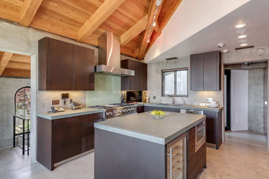 This kitchen features an L-shaped kitchen counter along with a center island. Images courtesy of Toptenrealestatedeals.com.