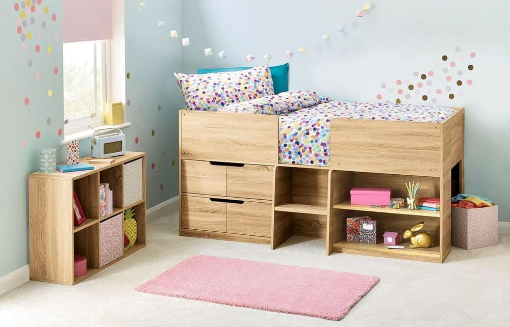 A kid's bedroom with bunk storage bed, open shelving cabinet, and painted walls with a window.