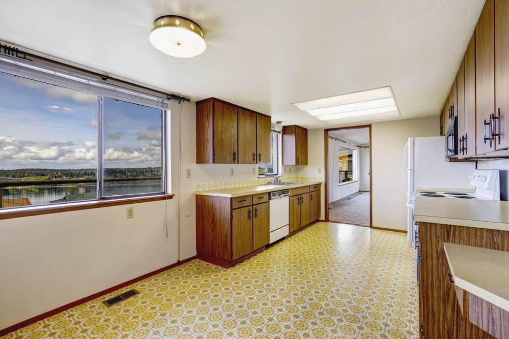 Kitchen with linoleum flooring.
