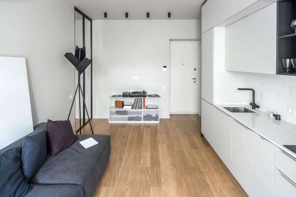 Modern kitchen with vinyl flooring.