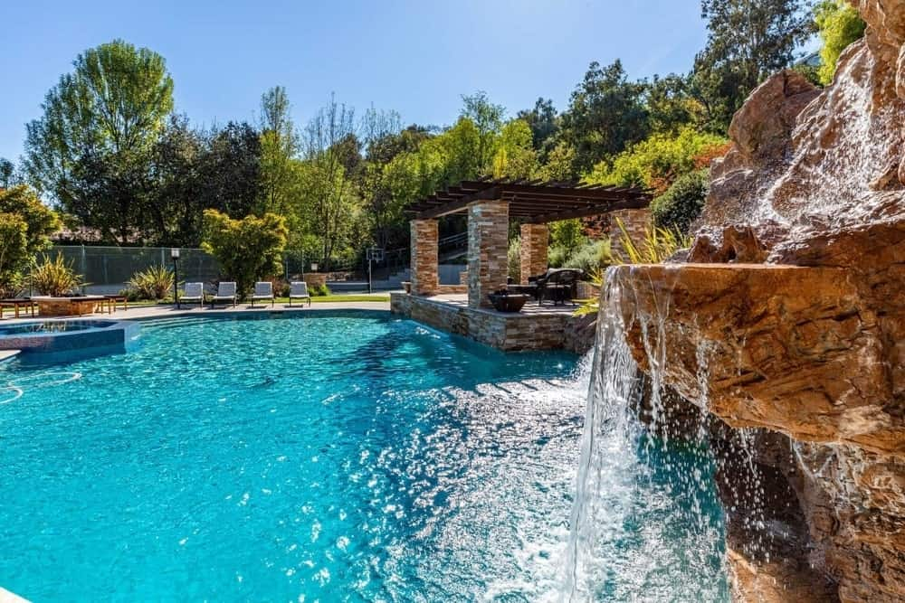 Here's a look at the property's beautiful large custom swimming pool set on the backyard surrounded by the greenery. Images courtesy of Toptenrealestatedeals.com.