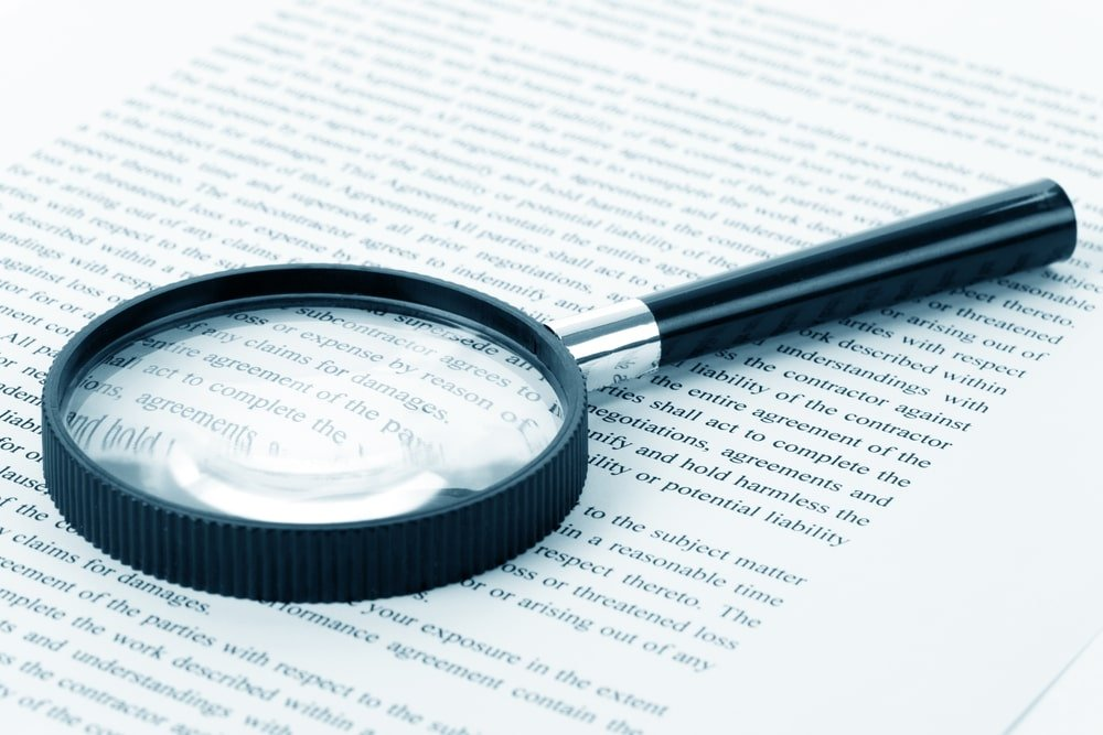 Magnifying glass on a document.