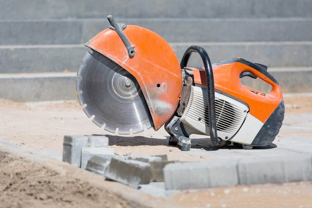 A heavy-duty hand held Concrete saw tool equipment at a construction site