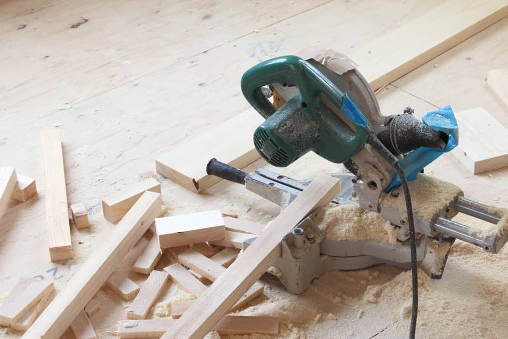 A photograph of a circular saw and the thin pieces of wood that it cut.