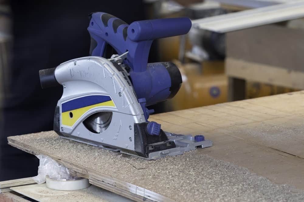 A beautiful piece of track saw equipment on a large plank of wood.