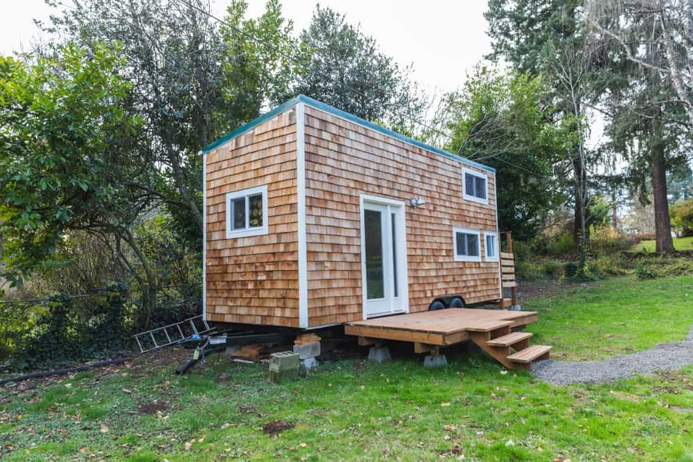 Mobile tiny home with wood siding.