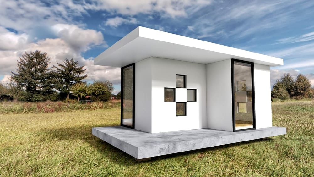 Modern white tiny home in a natural landscape.