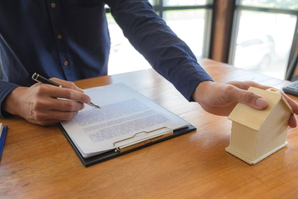 Signing a mortgage purchase contract.