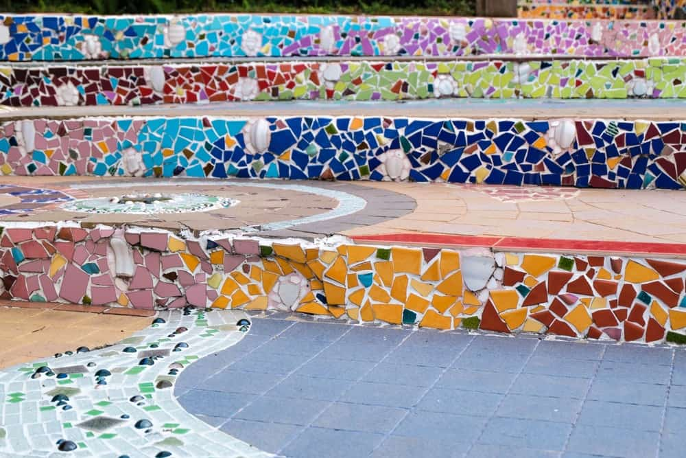 Mosaic stair riser on outdoor steps.