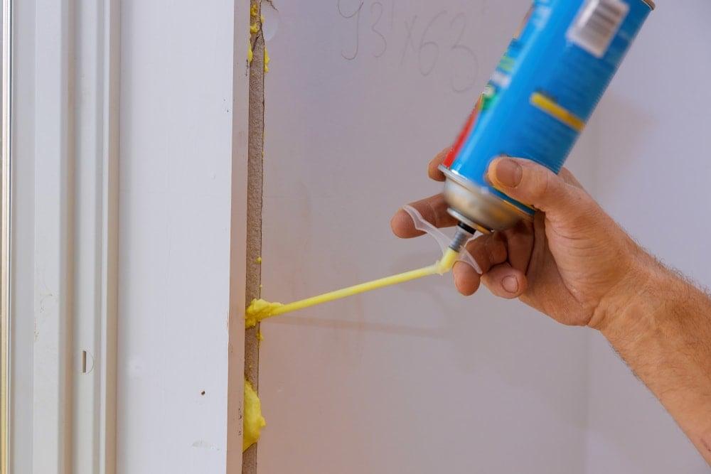 Polyurethane spray used to seal a window.