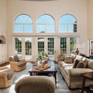 The formal living room is so spacious. It offers a cozy set of seats lighted by table lamps, set on top of a large area rug. The room also offers a fireplace with a TV set just above it. Images courtesy of Toptenrealestatedeals.com.