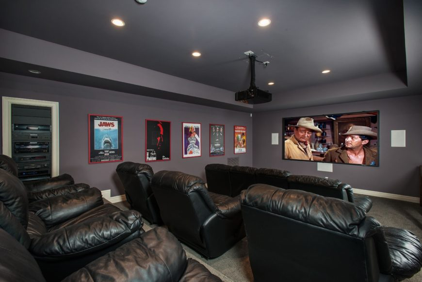 There's a home theater as well featuring gray walls and a gray ceiling with recessed ceiling lights. The room offers a set of cozy sectional seats. Images courtesy of Toptenrealestatedeals.com.