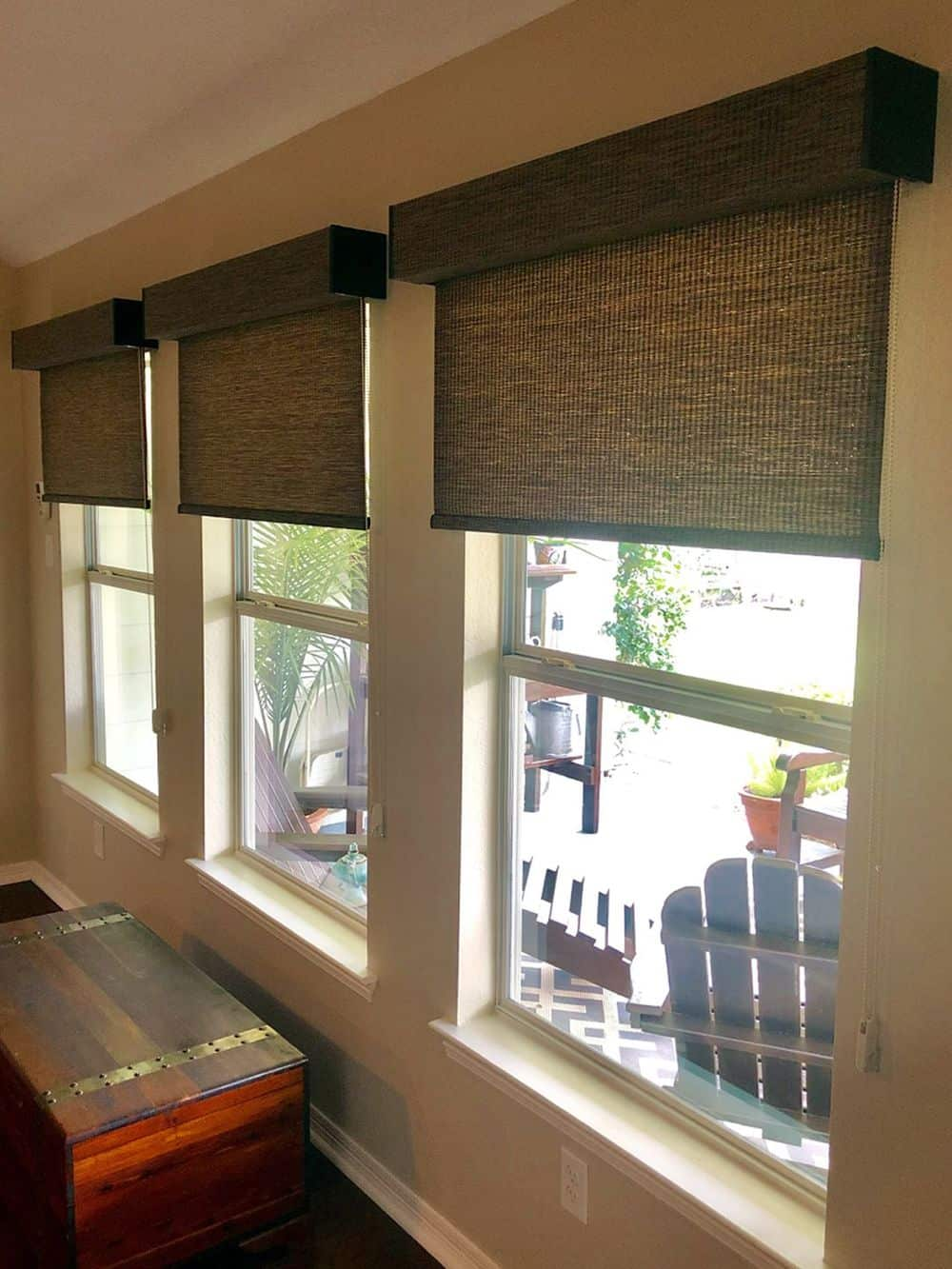 This house boasts glass windows with stylish window shades. It also has hardwood floors and beige walls.