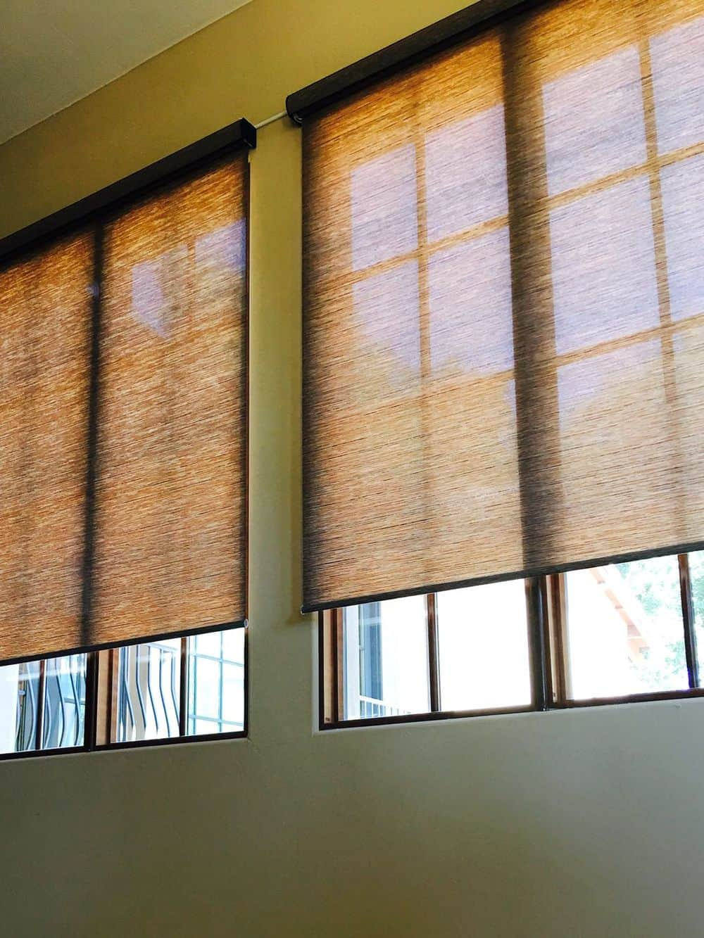 A focused look at this house's vertical windows featuring roller window shades.