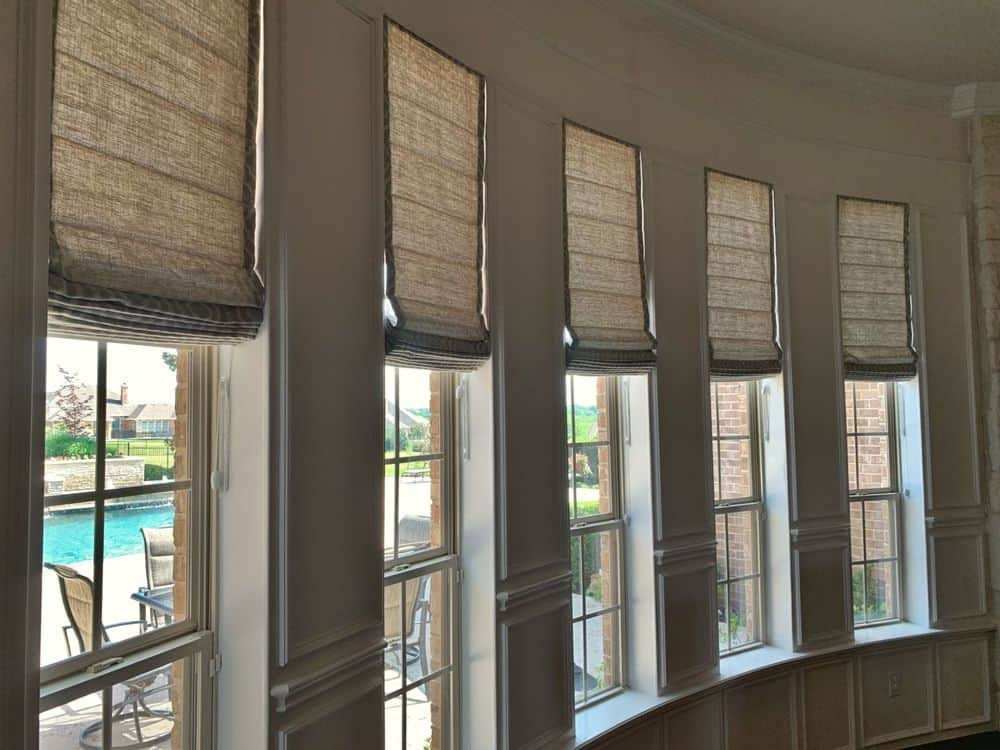 A closer look at this home's beautiful windows featuring Roman-style window shades.