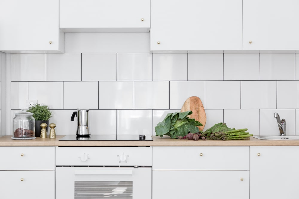 Scandinavian white tile kitchen backsplash.