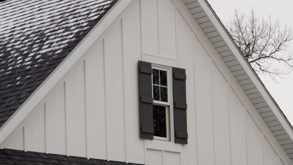 Board and batten siding with board and batten attic window.