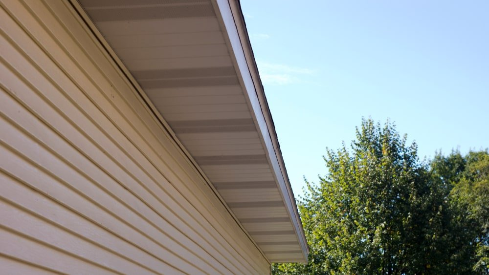Soffit fascia and siding on a home exterior.