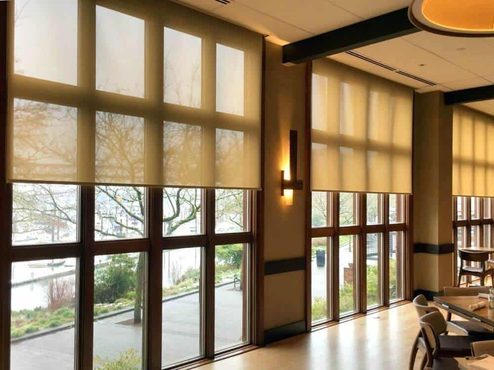 This large mansion boasts a custom ceiling and well-polished flooring, along with multiple glass windows featuring solar shades. The wall lights also look beautiful.