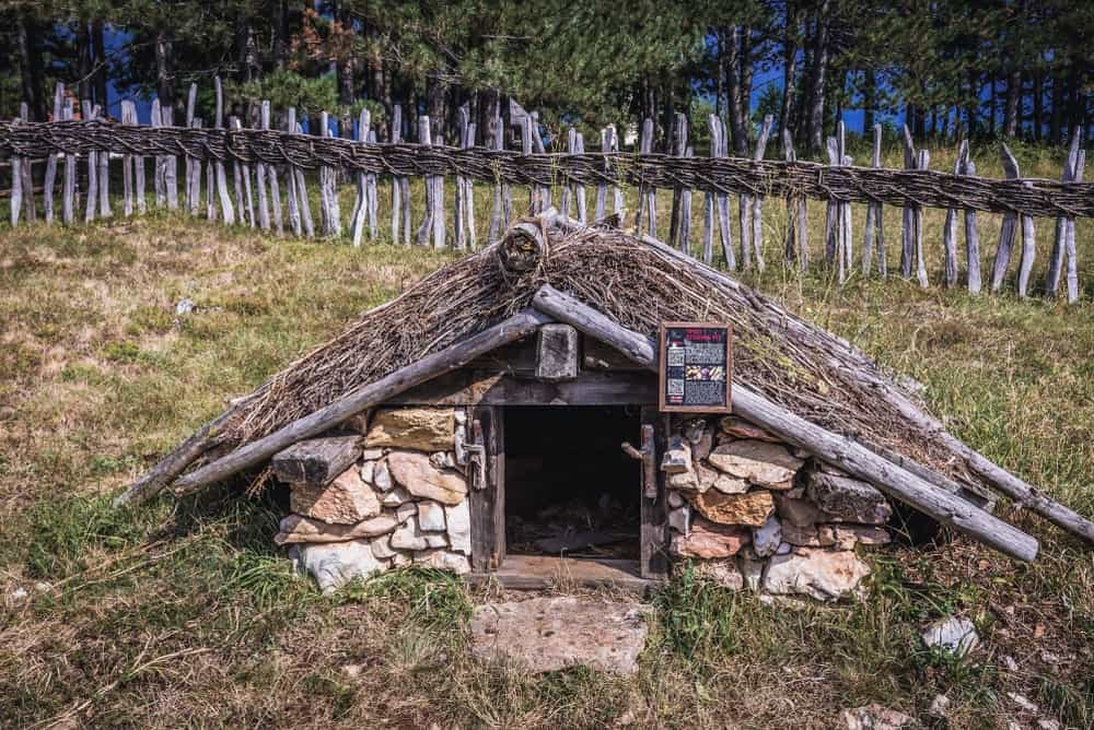 A traditional earth cellar located in a museum in Sirogojno village, Serbia. It is protected by a traditional wooden fence.