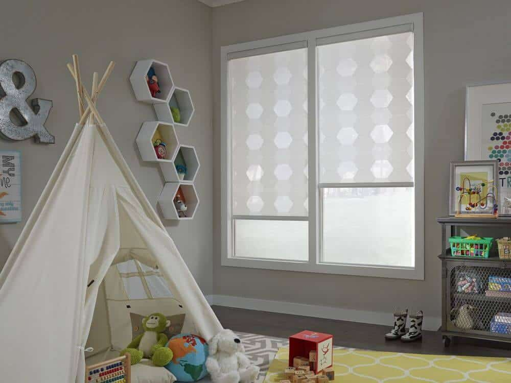 A nursery room featuring a cute camp and colorful area rugs covering the hardwood flooring. The room has multiple wall decors and shelving on the wall.