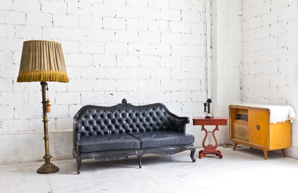 Vintage furniture against whitewashed brick walls.