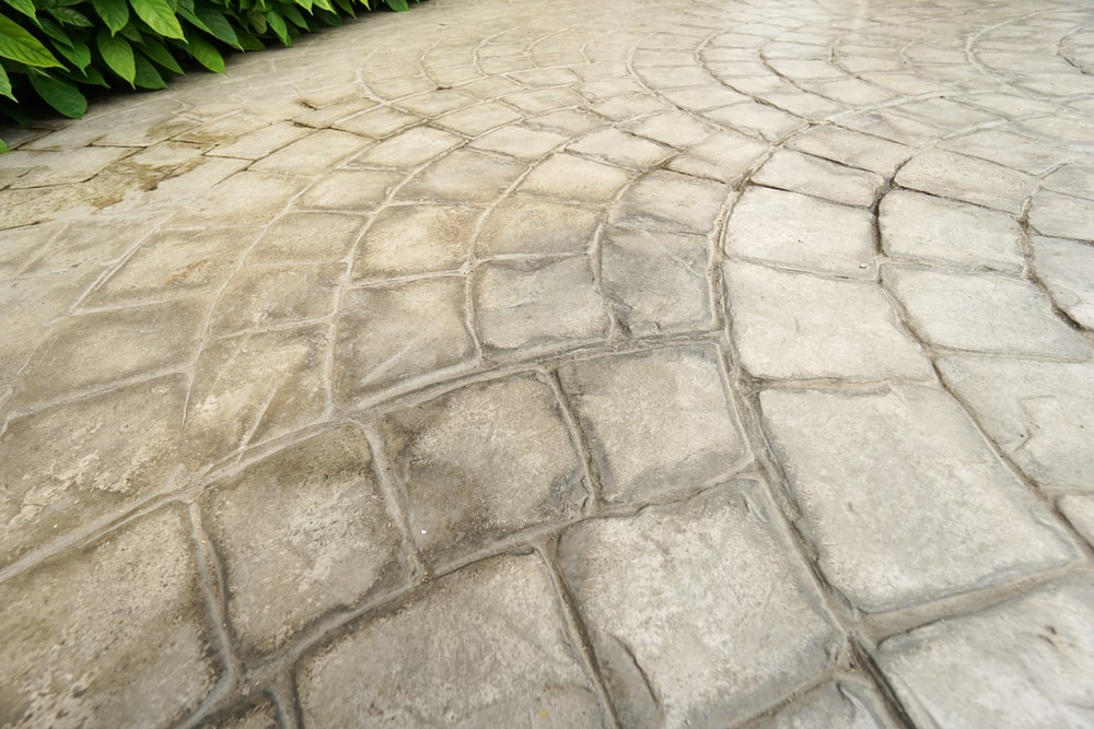 Rough stone stamped concrete walkway.