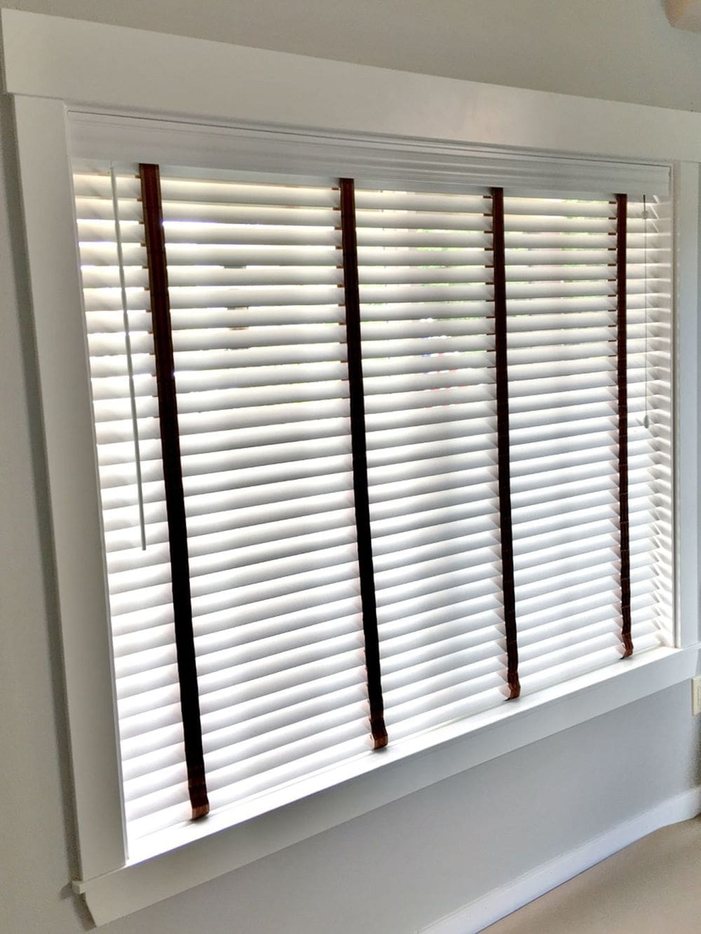 A closer look at this home's window and window blinds that look perfect with each other.