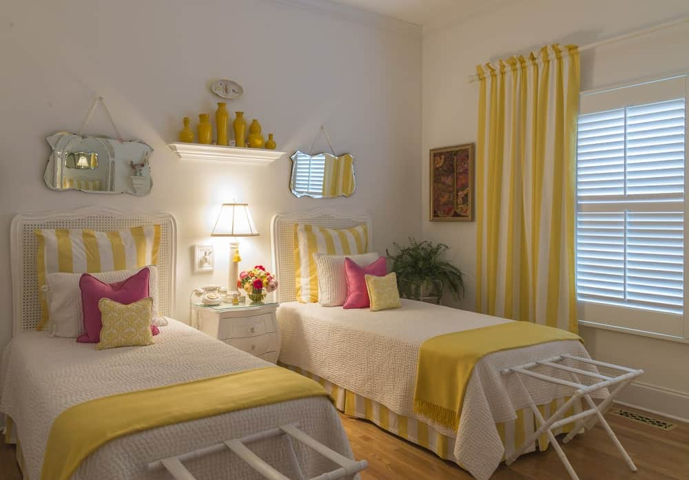 Yellow bedroom with twin beds.