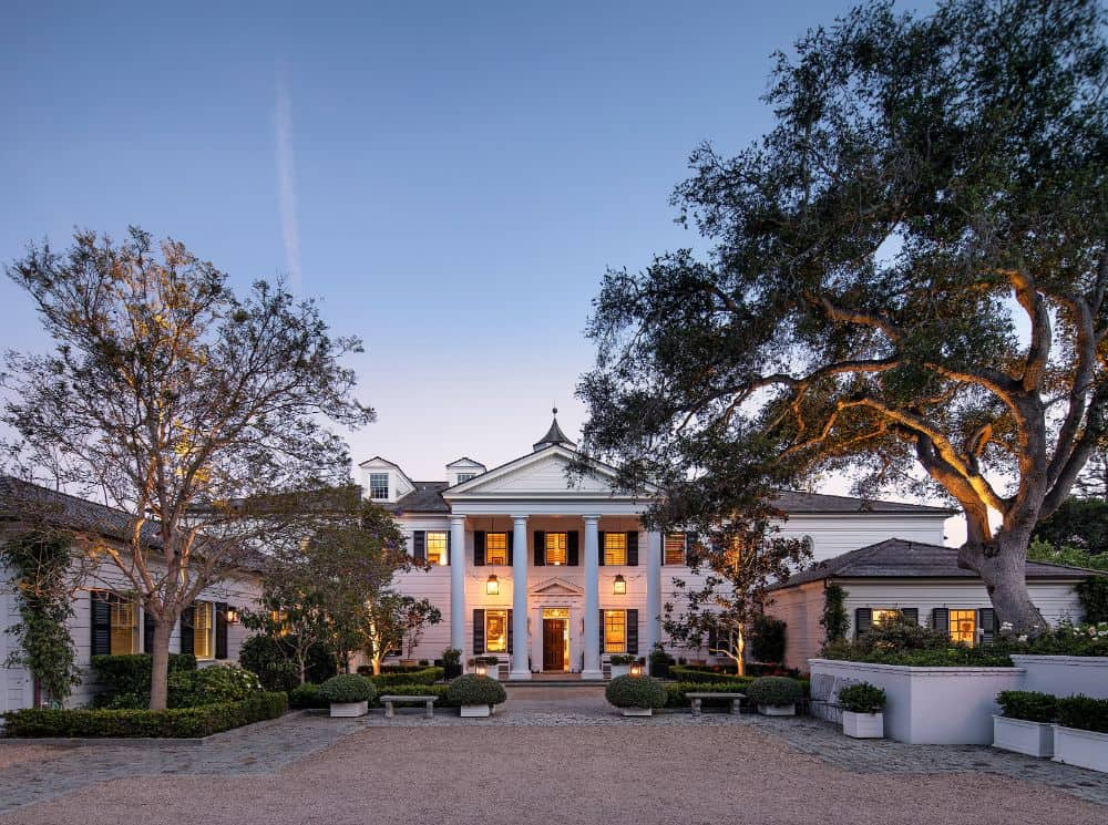 A view of Rob Lowe's spectacular mansion from its outdoors, showcasing the property's beautiful architectural and landscaping design.