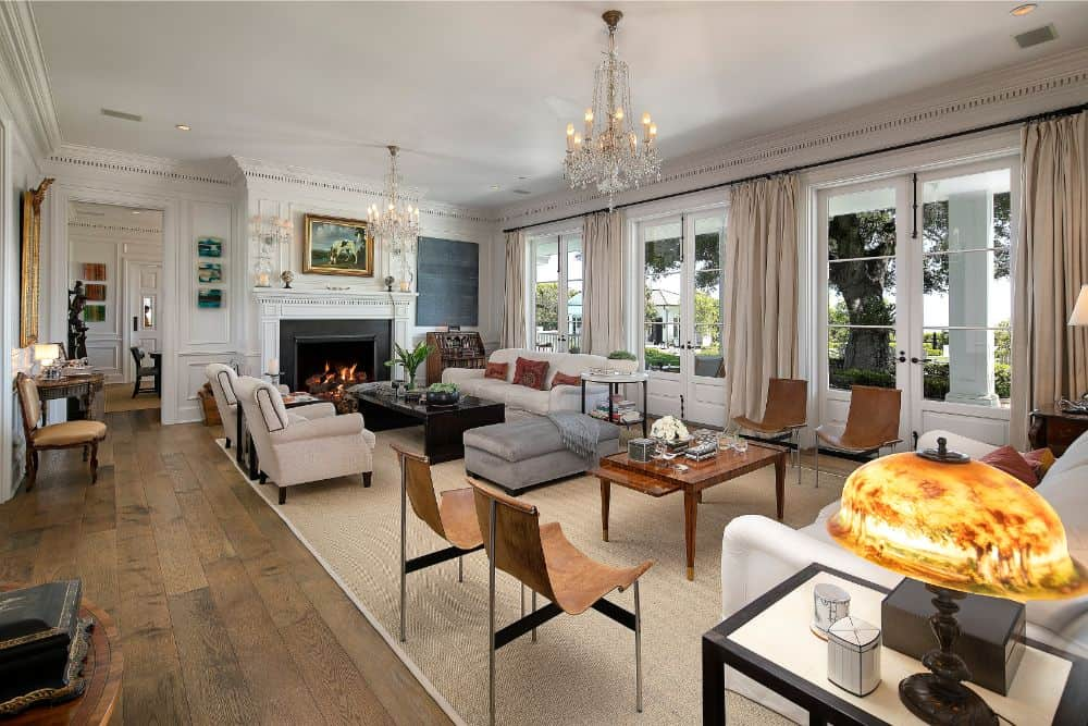 This is the home's large formal living room boasting elegant pieces of furniture along with a large classy fireplace and two gorgeous chandelier lighting. Images courtesy of Toptenrealestatedeals.com.