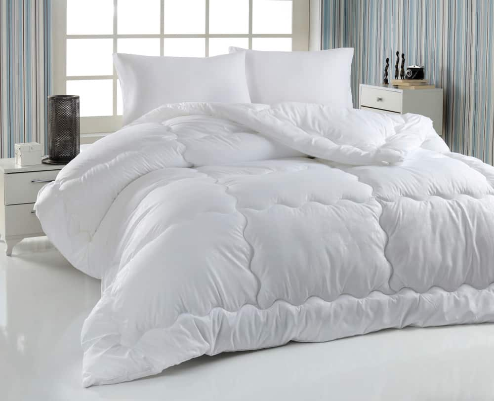 Bed with white duvet