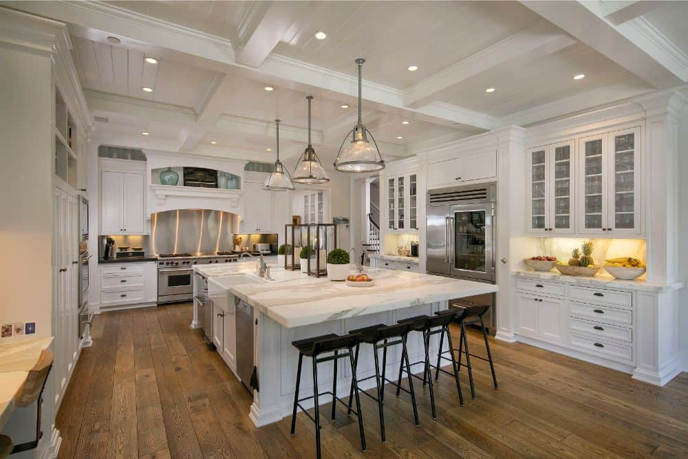 The kitchen is large as well, featuring hardwood flooring and a coffered ceiling. It also offers a massive center island with space for a breakfast bar. Images courtesy of Toptenrealestatedeals.com.