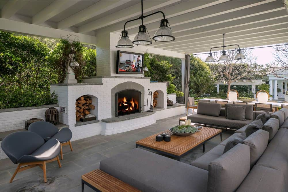 There's an outdoor living space as well, boasting a large modern gray sofa set with a fireplace and widescreen TV placed in front. Images courtesy of Toptenrealestatedeals.com.