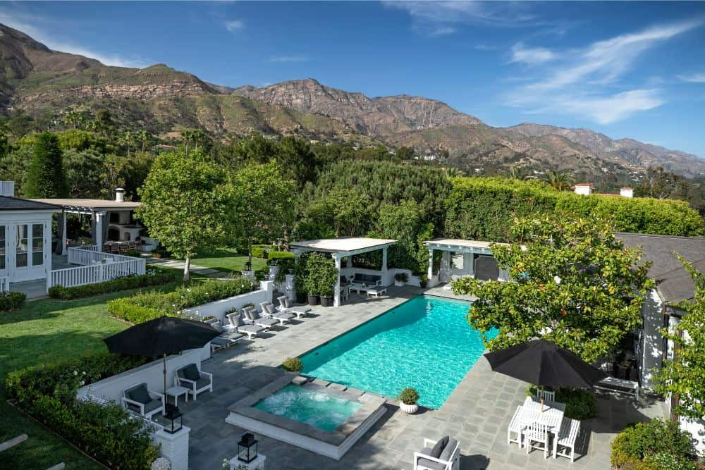 An aerial view of the home's swimming pool area, set on the side of the backyard garden. Images courtesy of Toptenrealestatedeals.com.