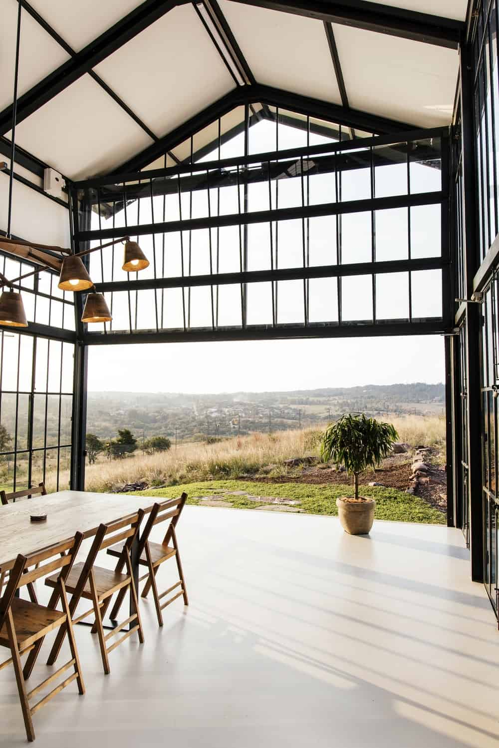Dining area overlooking the expansive view in The Conservatory designed by Nadine Engelbrecht.