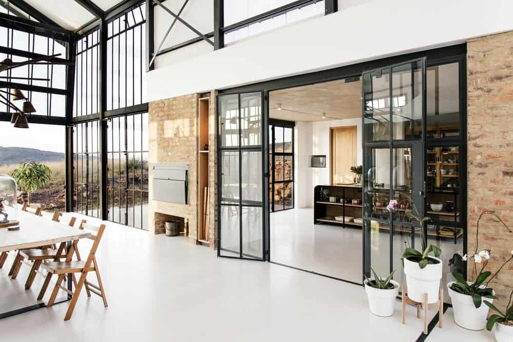 French door between dining area and kitchen in The Conservatory designed by Nadine Engelbrecht.