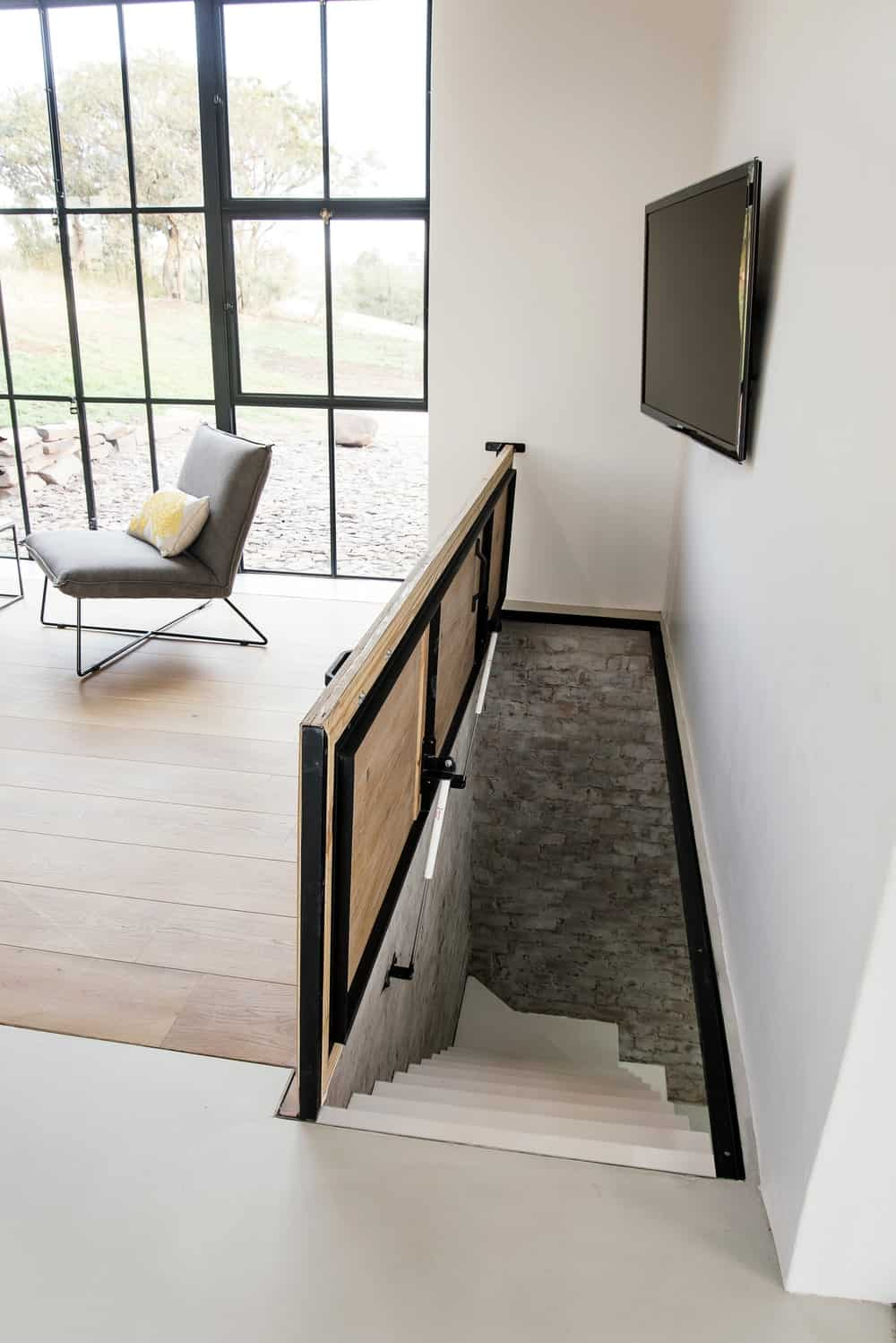 Staircase leading to the basement in The Conservatory designed by Nadine Engelbrecht.
